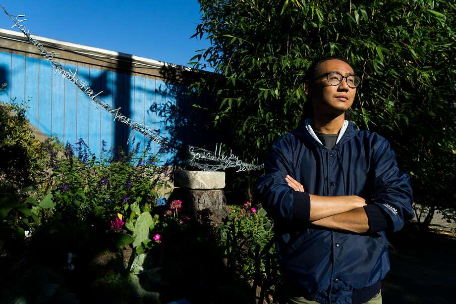 Artist Chong Hu stands in front of his sculpture at the garden in San Francisco's Dogpatch neighborhood, which has been brought to life by local resident Topher Delaney. Photo: James Tensuan, Special To The Chronicle