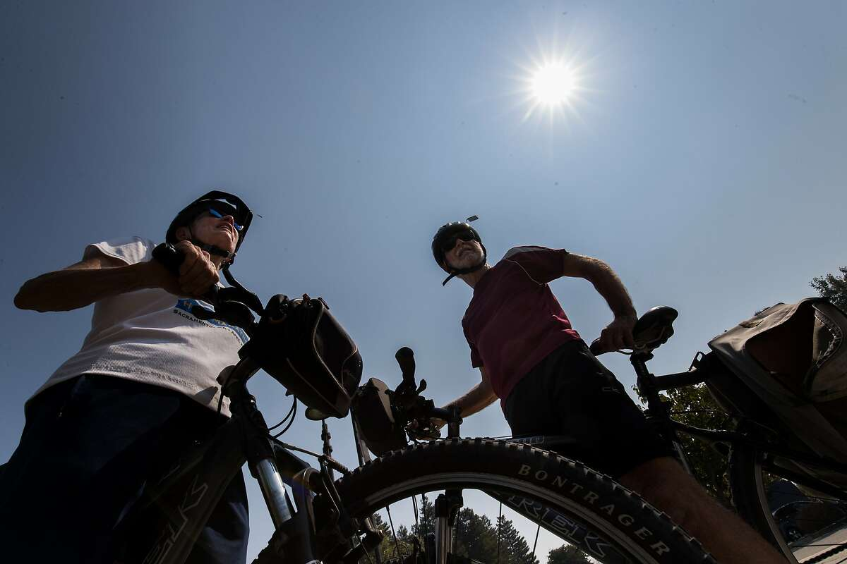Barbara, 73, and Phil, 74 Brady ride their bikes at the beginning of a heat wave on Thursday, Aug. 31, 2017 in Livermore, CA