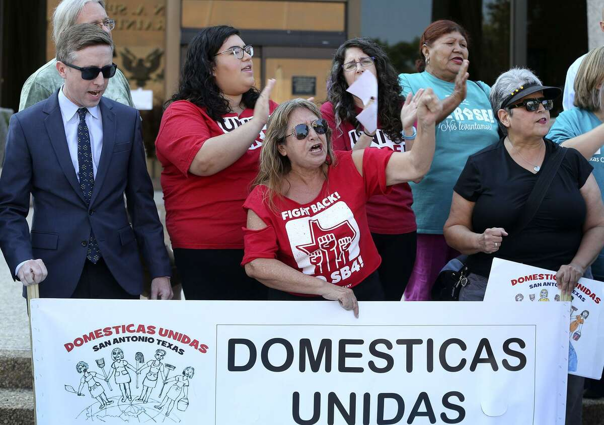 Araceli Herrera (center, arm raised) leads a chant Thursday August 31, 2017 in front of the John Wood Federal Courthouse on East Ceasar Chavez Boulevard after U.S. District Court Judge Orlando Garcia halted most of Texas?' ban on sanctuary cities Wednesday ?- two days before the law was to take effect. In his ruling, U.S. District Judge Orlando Garcia halted penalties for officials who endorse policies in violation of Senate Bill 4, saying it likely violates the First Amendment. SB 4 allows the attorney general to fine or remove from office local officials who ?