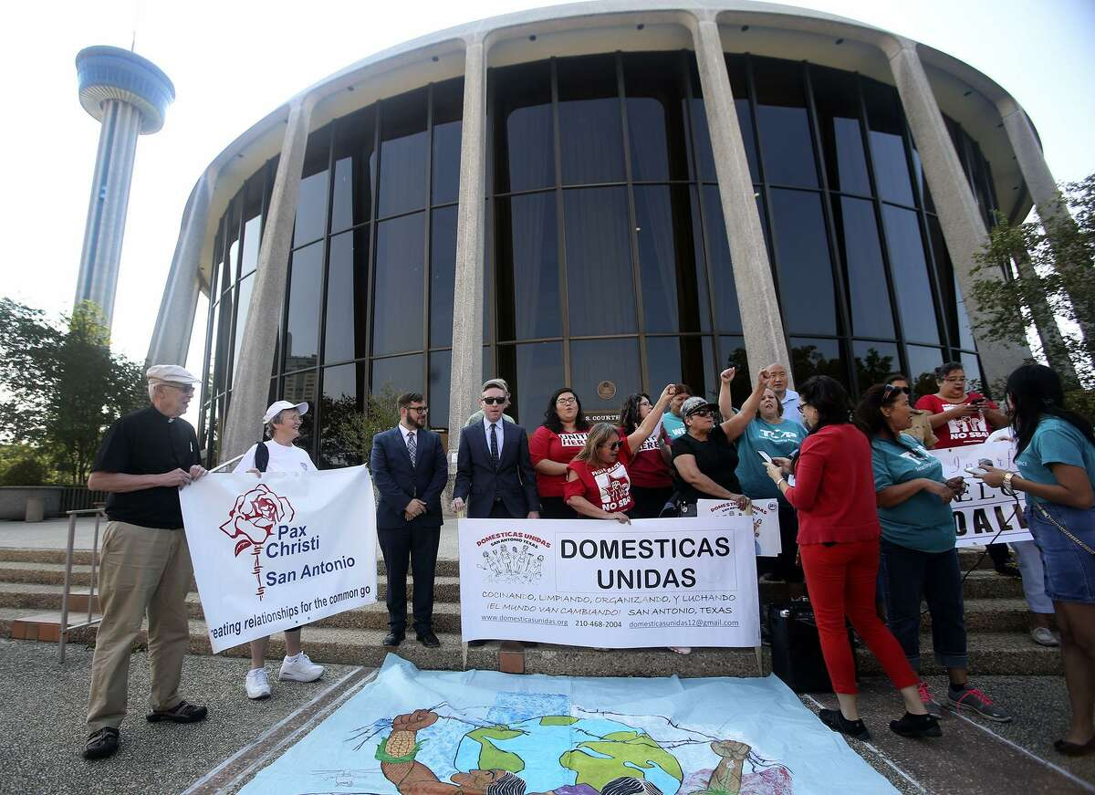 """Araceli Herrera (center, arm raised) leads a chant Thursday August 31, 2017 in front of the John Wood Federal Courthouse on East Ceasar Chavez Boulevard after U.S. District Court Judge Orlando Garcia halted most of Texas?' ban on sanctuary cities Wednesday ?- two days before the law was to take effect. In his ruling, U.S. District Judge Orlando Garcia halted penalties for officials who endorse policies in violation of Senate Bill 4, saying it likely violates the First Amendment. SB 4 allows the attorney general to fine or remove from office local officials who ?""""adopt, enforce, or endorse a policy under which the entity or department prohibits or materially limits the enforcement of immigration laws.?"""" The law also creates penalties for local officials who block police from asking about immigration status."""