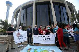 Araceli Herrera (center, arm raised) leads a chant Thursday August 31, 2017 in front of the John Wood Federal Courthouse on East Ceasar Chavez Boulevard after U.S. District Court Judge Orlando Garcia halted most of Texas ban on sanctuary cities Wednesday two days before the law was to take effect. The Fifth Circuit Court of Appeals on Monday issued an emergency stay of Garcia's ruling that halted penalties for local jails that don't honor requests by immigration authorities to hold people suspected of being immigrants subject to deportation.