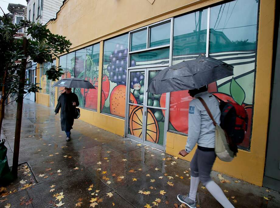 Pedestrians pass the former Real Food company which has been closed for years Tuesday December 2, 2014. A San Francisco, Calif. store on 24th Street that has been shuttered for 11 years will soon be the site of a new retail venture thanks in part to Carol Yenne who owns a store up the street. Photo: Brant Ward, The Chronicle