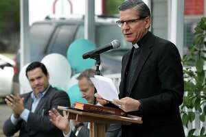 J. Antonio Fernandez, President and CEO of Catholic Charities, and Archbishop Gustavo Garcia-Siller last June at the opening of a facility on Bandera Road. Fernandez said Friday the agency expected to fill 50 trucks with relief supplies by the end of September for areas hit by Hurricane Harvey.
