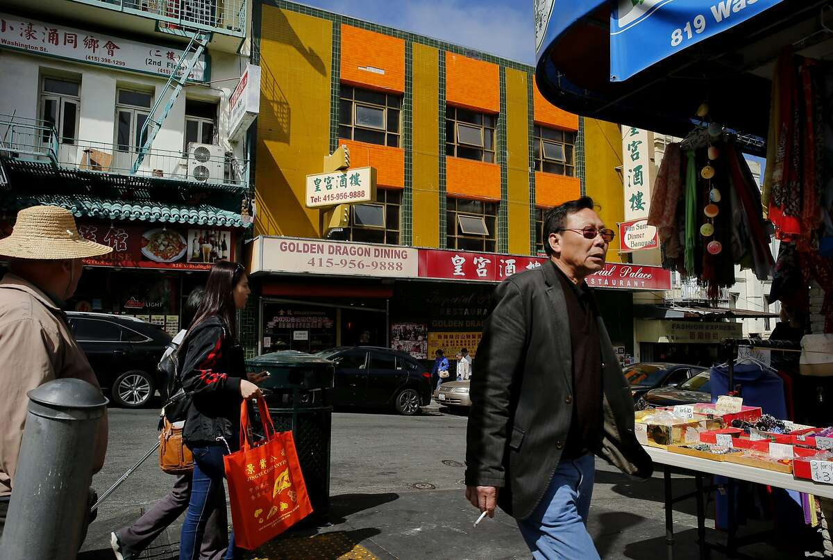 Pedestrians make their way through Chinatown past the Imperial Palace Restaurant on Tuesday, Aug. 29, 2017, in San Francisco, Calif. The Imperial Palace was formerly the Golden Dragon Restaurant, where the Golden Dragon Massacre took place on Sept. 4, 1977.