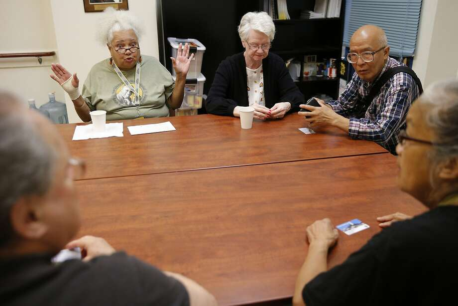 Diane Evans (top left) and a group at the Curry Senior Center talk about current events including Hurricane Harvey. Evans evacuated to San Francisco from New Orleans during Hurricane Katrina in 2005. Photo: Santiago Mejia, The Chronicle