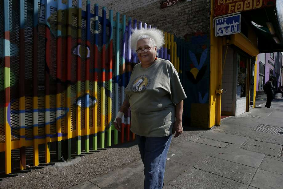 Diane Evans takes a walk through the Tenderloin neighborhood as she heads home to the Curry Senior Center in San Francisco. Evans evacuated to San Francisco from New Orleans during Hurricane Katrina in 2005. Photo: Santiago Mejia, The Chronicle