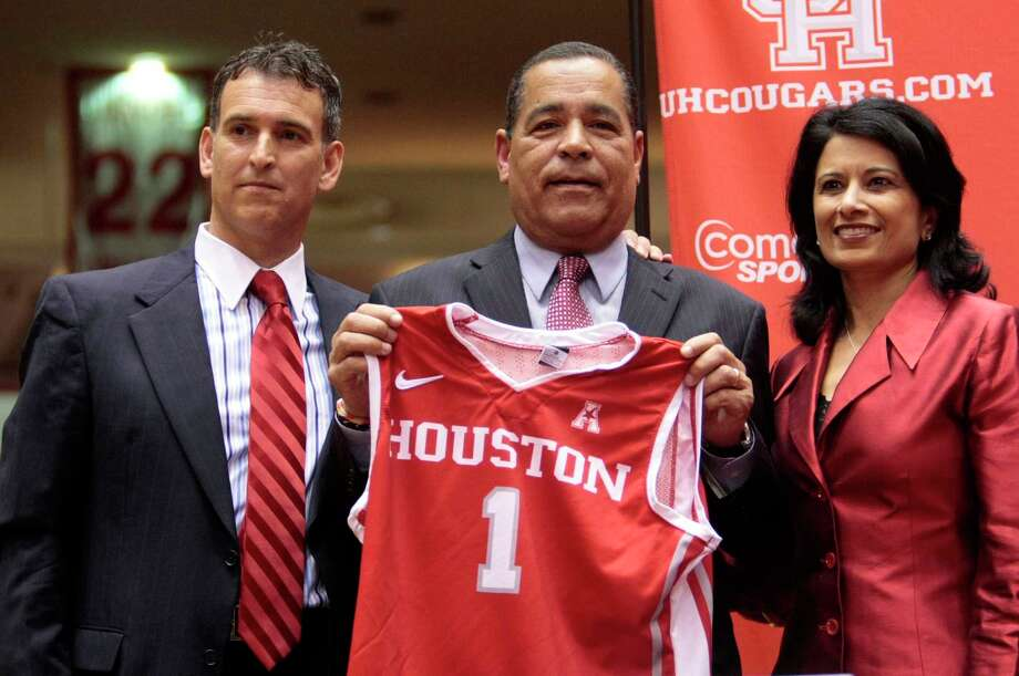 Then-athletic director Mack Rhoades (left), stands with  Kelvin Sampson and University of Houston President Dr. Renu Khator after Sampson was introduced as the University of Houston's new head basketball coach, Thursday April 3, 2014 at Hofheinz Pavilion. Sampson's late father had told him he was best suited to coach college basketball rather than in the NBA. Photo: Billy Smith II, Staff / © 2014 Houston Chronicle