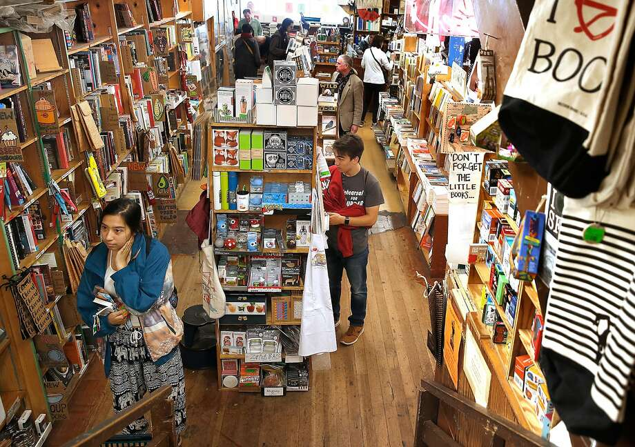 Browsing during the lunch hour at Green Apple Books on Tuesday, August 29, 2017, in San Francisco, Calif.   Green Apple Books will soon celebrate its 50th year as a local bookstore. Photo: Liz Hafalia, The Chronicle