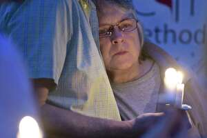 Pat O'Neil, of Bethel, leans into her husband Bob O'Neil during the HERO Project (Heroin Education to resist Opiates) candlelight vigil in honor of those who have lost their lives to overdose, O'Neil lost her son Steven to an overdose.