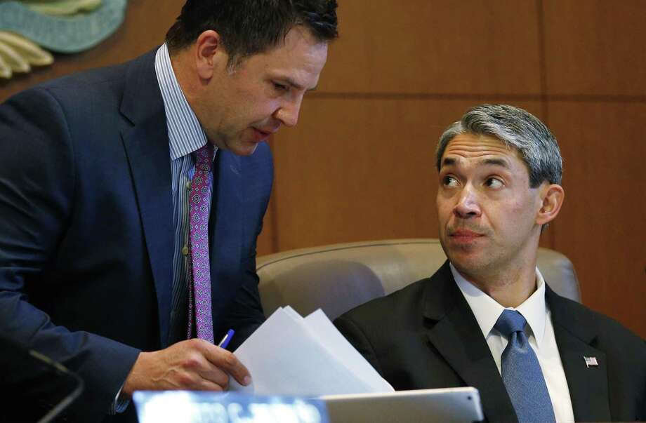 Deputy City Manager Peter Zanoni (left) and Mayor Ron Nirenberg chat before a recent City Council meeting. The council has voted to raise the minimum hourly wage paid to city employees to $15 by 2019. Is turnover at the city or county so high that it makes a salary adjustment necessary? Are these employees providing service to the citizens greater than their cost to the city/taxpayer? Photo: Kin Man Hui /San Antonio Express-News / ©2017 San Antonio Express-News