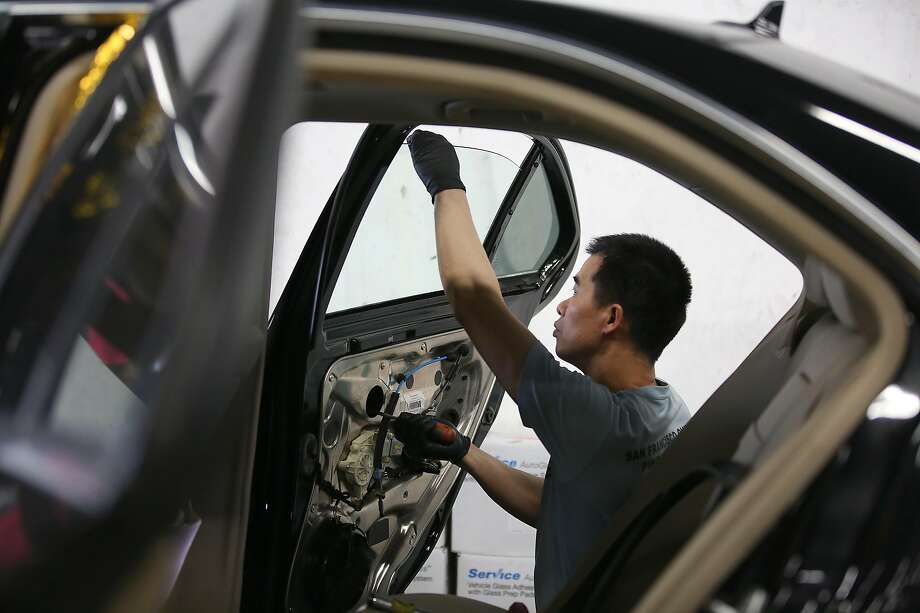 Jimmy Lee works on a passenger side rear glass on a Mercedes C300  at TLC Auto Glass after a break in on Thursday, August 31, 2017, in San Francisco, Calif. Photo: Liz Hafalia, The Chronicle