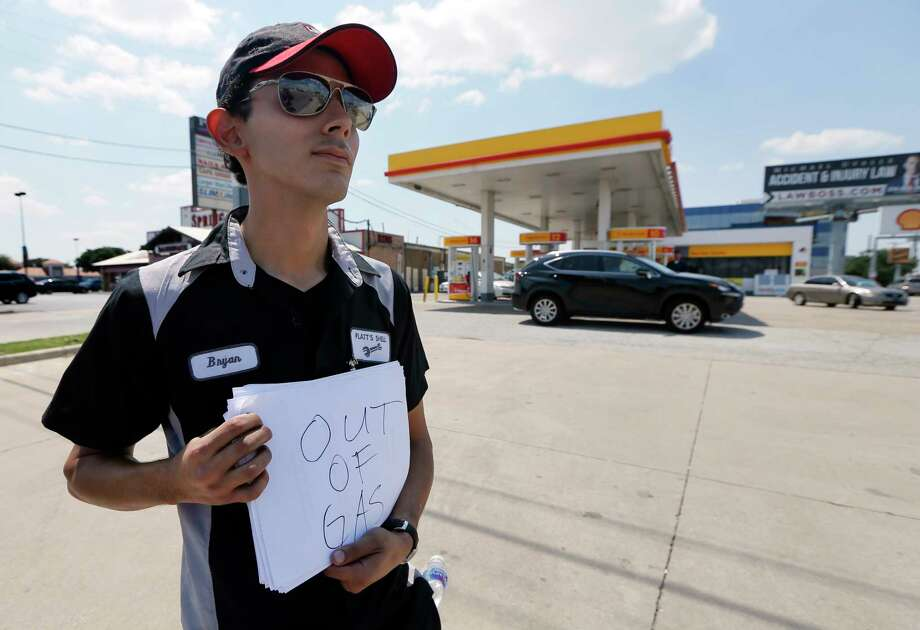 Bryan Herrera holds a makeshift sign Thursday at a Shell station in north Dallas to wave away motorists seeking gasoline after the station ran out.See how Hurricane Harvey has impacted Houston using the latest numbers shared by officials... Photo: Tony Gutierrez, STF / Copyright 2017 The Associated Press. All rights reserved.