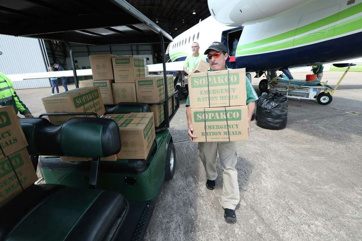 MillionAir employee Mark Rodriguez aids in unloading MREs from a business aircraft filled with supplies for Hurricane Harvey victims Thursday, Aug. 31, 2017, in Houston. ( Steve Gonzales / Houston Chronicle )