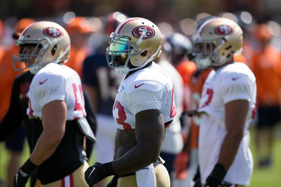 San Francisco 49ers linebacker NaVorro Bowman, center, awaits the next play during a practice at the team�s headquarters during a joint workout with the Denver Broncos, on Wednesday, Aug. 16, 2017 in Santa Clara, Calif.