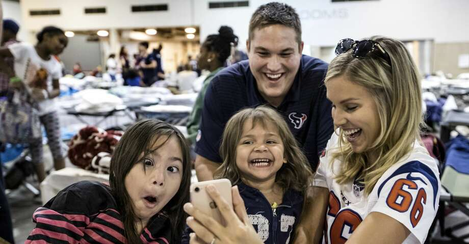 PHOTOS: Texans at NRG CenterHouston Texans center Nick Martin and his fiance Kathleen Patterson play with Aaliyah Vasquez and her sister Maria, of Dickinson, during a visit by Texans players to neighbors displaced by Tropical Storm Harvey at NRG Center on Thursday, Aug. 31, 2017, in Houston. ( Brett Coomer/Houston Chronicle via AP)Browse through the photos to see Texans players visiting with hurricane victims at NRG Center. Photo: Brett Coomer, Associated Press