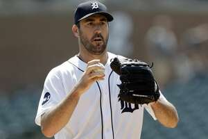 Detroit Tigers starting pitcher Justin Verlander prepares to throw during the first inning of a baseball game against the Los Angeles Dodgers, Sunday, Aug. 20, 2017, in Detroit. (AP Photo/Carlos Osorio)