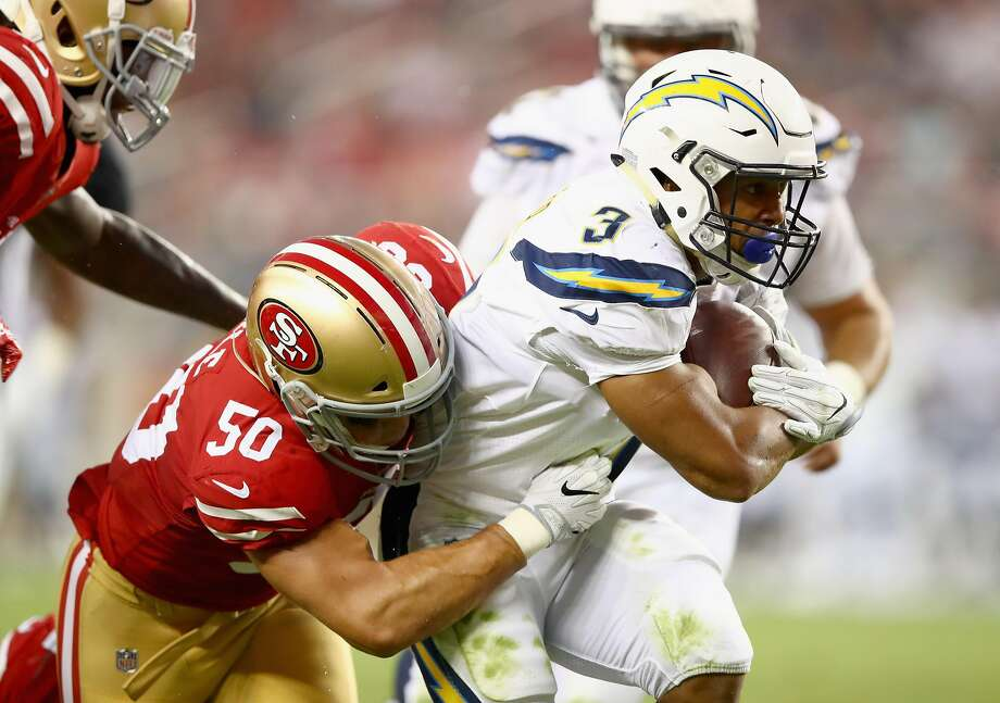 SANTA CLARA, CA - AUGUST 31:  Austin Ekeler #3 of the Los Angeles Chargers is tackled by Brock Coyle #50 of the San Francisco 49ers at Levi's Stadium on August 31, 2017 in Santa Clara, California.  (Photo by Ezra Shaw/Getty Images) Photo: Ezra Shaw, Getty Images
