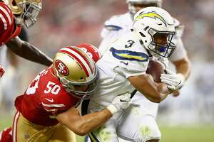 SANTA CLARA, CA - AUGUST 31:  Austin Ekeler #3 of the Los Angeles Chargers is tackled by Brock Coyle #50 of the San Francisco 49ers at Levi's Stadium on August 31, 2017 in Santa Clara, California.  (Photo by Ezra Shaw/Getty Images)