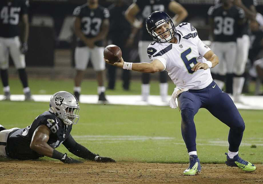 Davis, 28, was signed in May 2017 to battle with Trevone Boykin for the role of Russell Wilson's understudy. Davis won the job, though his services were ultimately not needed during the regular season as Wilson played all 16 games File Photo - Seattle Seahawks quarterback Austin Davis (6) passes in front of Oakland Raiders linebacker LaTroy Lewis (46) during the second half of an NFL preseason football game in Oakland, Calif., Thursday, Aug. 31, 2017. (AP Photo/Eric Risberg) Photo: Eric Risberg, Associated Press