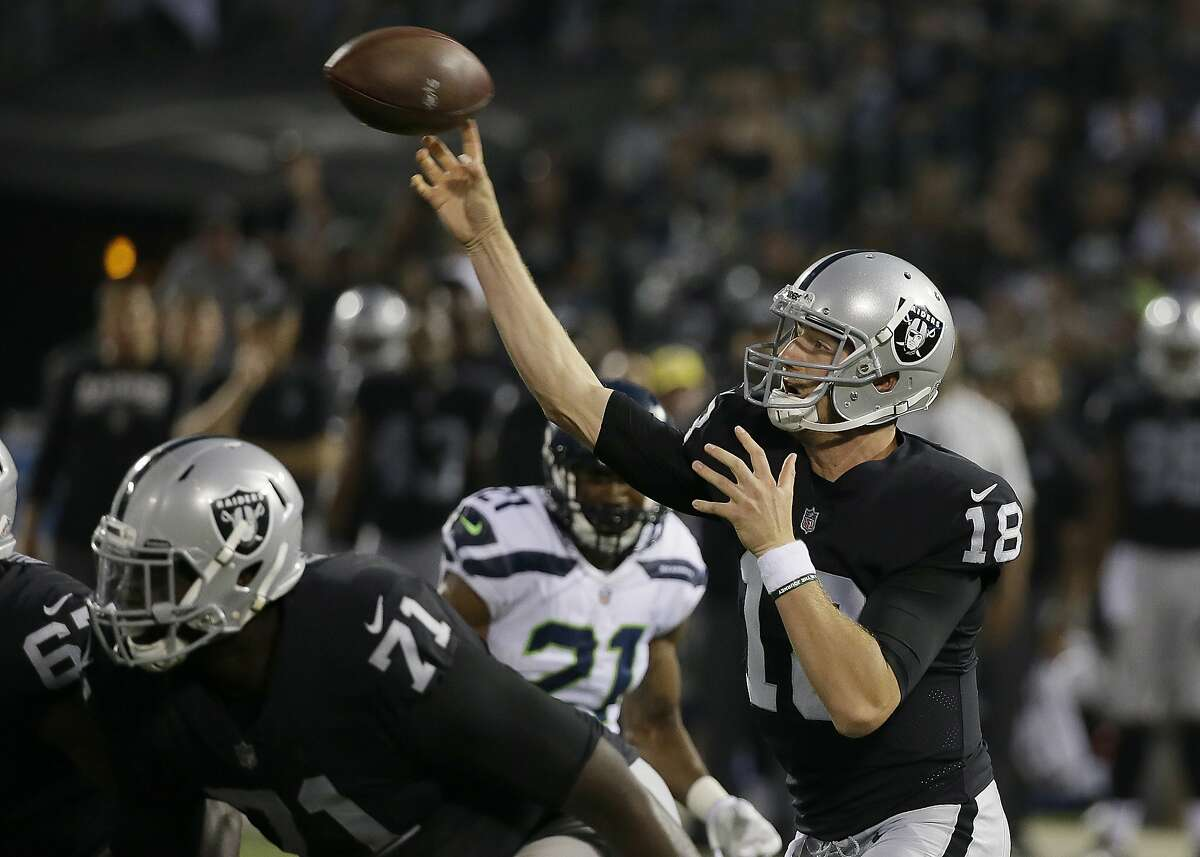 Oakland Raiders quarterback Connor Cook (18) passes against the Seattle Seahawks during the first half of an NFL preseason football game in Oakland, Calif., Thursday, Aug. 31, 2017. (AP Photo/Eric Risberg)