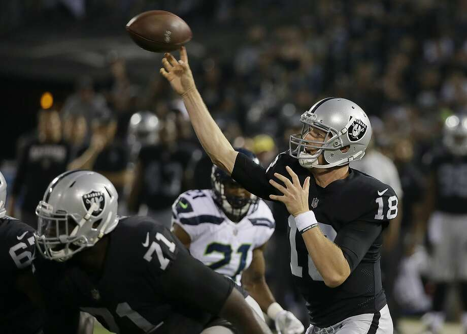 Oakland Raiders quarterback Connor Cook (18) passes against the Seattle Seahawks during the first half of an NFL preseason football game in Oakland, Calif., Thursday, Aug. 31, 2017. (AP Photo/Eric Risberg) Photo: Eric Risberg, Associated Press