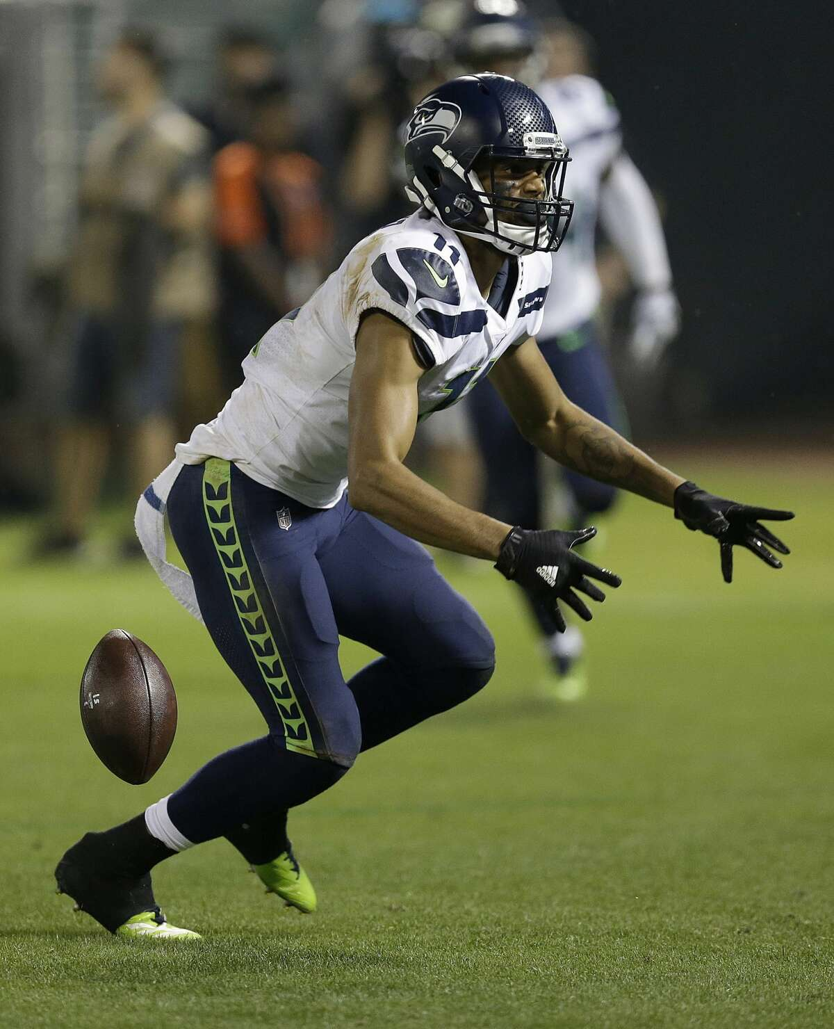 Seahawks wide receiver Kenny Lawler celebrates after scoring the game-winning touchdown.