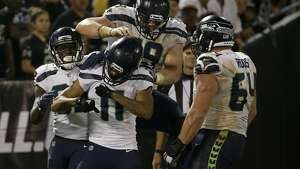 Seattle Seahawks wide receiver Kenny Lawler (11) celebrates with teammates after scoring a touchdown during the second half of an NFL preseason football game against the Oakland Raiders in Oakland, Calif., Thursday, Aug. 31, 2017. (AP Photo/Eric Risberg)
