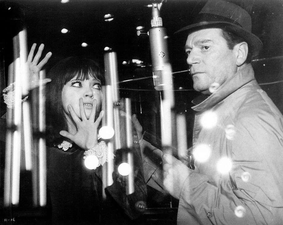 "Anna Karina and Eddie Constantine in Jean-Luc Godard's ""Alphaville"" (1965). Photo: Criterion Collection, 1966"