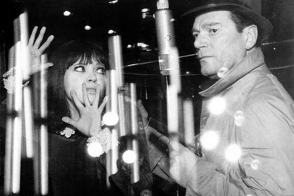 """Anna Karina and Eddie Constantine in Jean-Luc Godard's """"Alphaville"""" (1966)."""