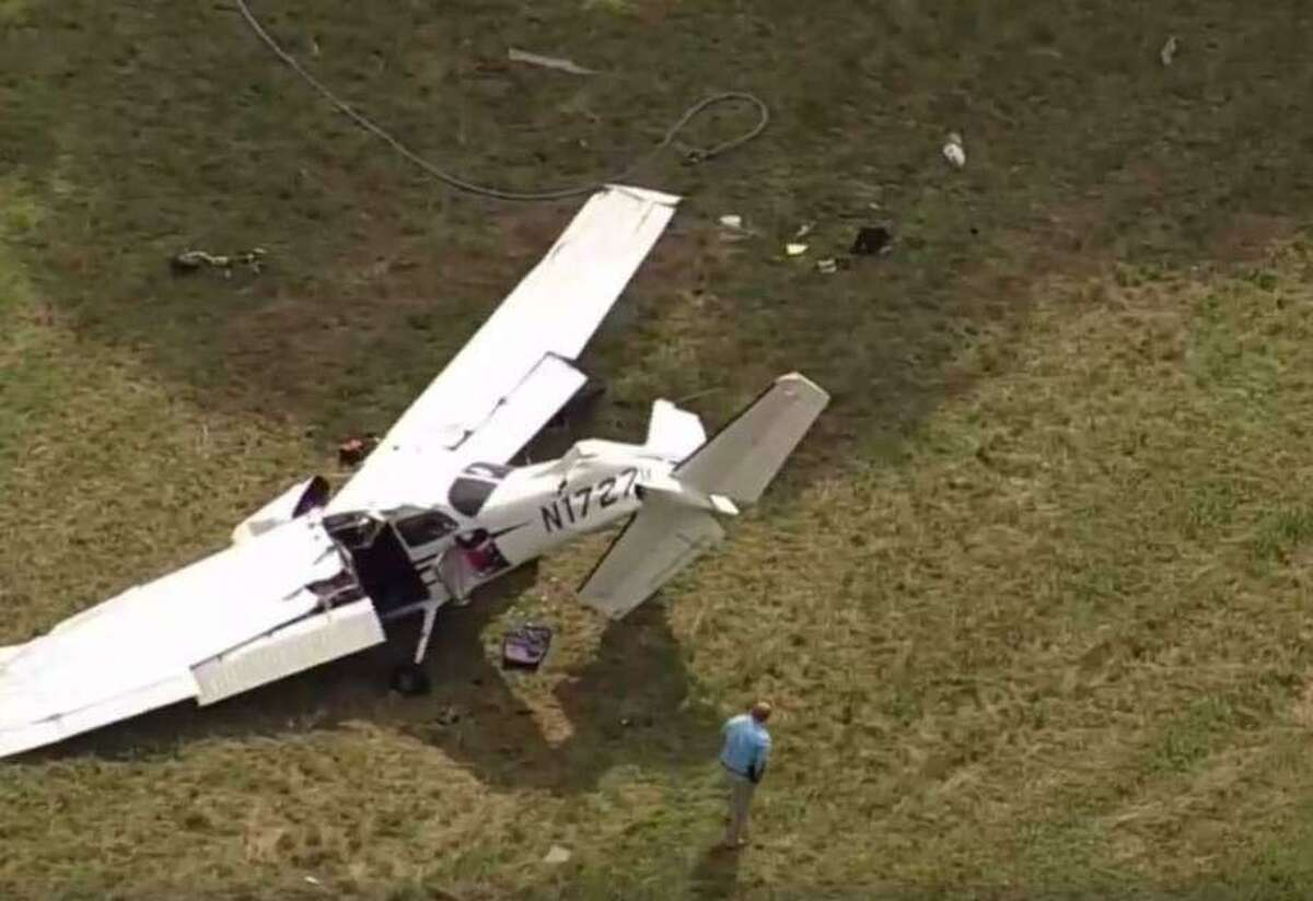 A man is dead and two people are injured after a plane from Danbury Municipal Airport crashed at Candlelight Farms Airport in New Milford, Conn. on Friday, August 11, 2017.