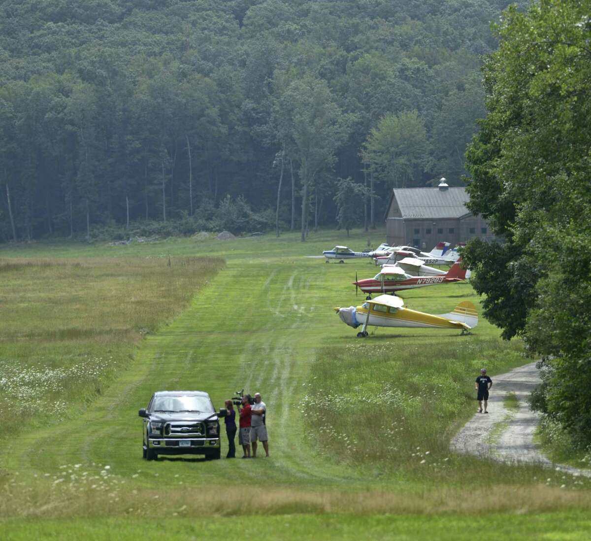 An airplane owner talks with the media at Candlelight Farms Airport where a plane from Danbury Municipal Airport crashed on, Friday, August 11, 2017, in New Milford, Conn.