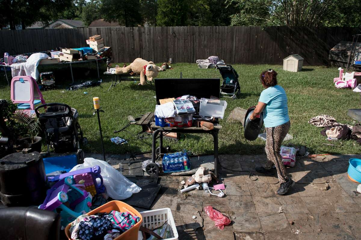 Personal items are seen as a homeowner salvages items from a flooded home as residents begin the recovery process from Hurricane Harvey August 31, 2017 in Houston, Texas. / AFP PHOTO / Brendan Smialowski (Photo credit should read BRENDAN SMIALOWSKI/AFP/Getty Images)
