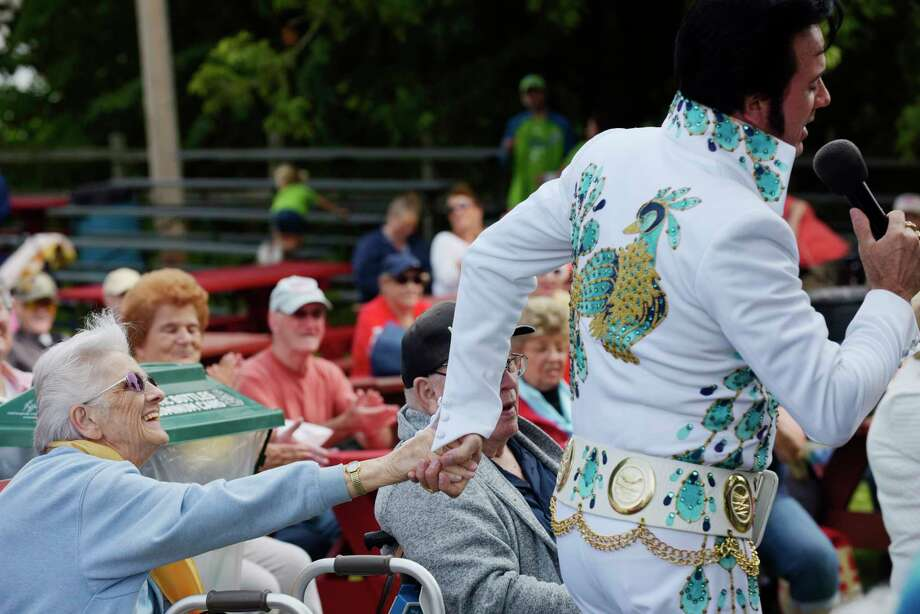 Lorraine Reeden of Rensselaer holds hands with Elvis impersonator, Don Romines, who performs as Donny Elvis,  at the Schaghticoke Fair on Thursday, Aug. 31, 2017, in Schaghticoke, N.Y.  The fair runs through Monday.        (Paul Buckowski / Times Union) Photo: PAUL BUCKOWSKI, Albany Times Union / 20041377A