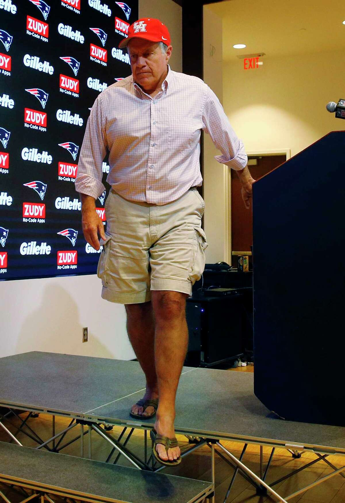 New England Patriots head coach Bill Belichick, wearing a University of Houston cap to show support for those affected by Tropical Storm Harvey in Houston, as he departs after speaking to the media following an NFL preseason football game against the New York Giants, Thursday, Aug. 31, 2017, in Foxborough, Mass. (AP Photo/Winslow Townson)