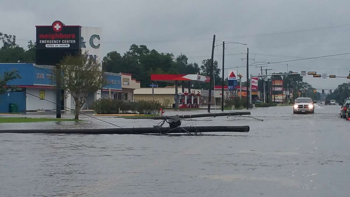 Water flooding and utility poles down on 16th Street in Orange. Photo provided by Eric Williams