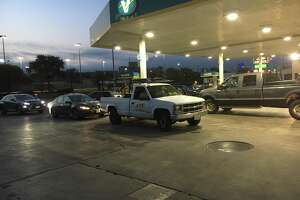 Cars wait to fuel up at a Valero gas station next to San Pedro Park Friday morning.