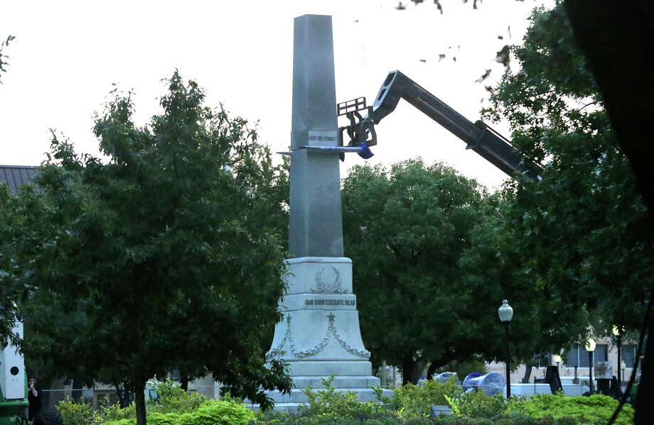 Crews work Friday September 1 , 2017 to remove the pedestal of the Confederate war memorial at Travis Park in San Antonio, Texas. The statue itself was removed earlier in the morning at about 2:00 a.m. and placed on a flatbed truck. San Antonio's City Council recently voted to have the memorial removed from the park. Photo: John Davenport, San Antonio Express-News / ©John Davenport/San Antonio Express-News