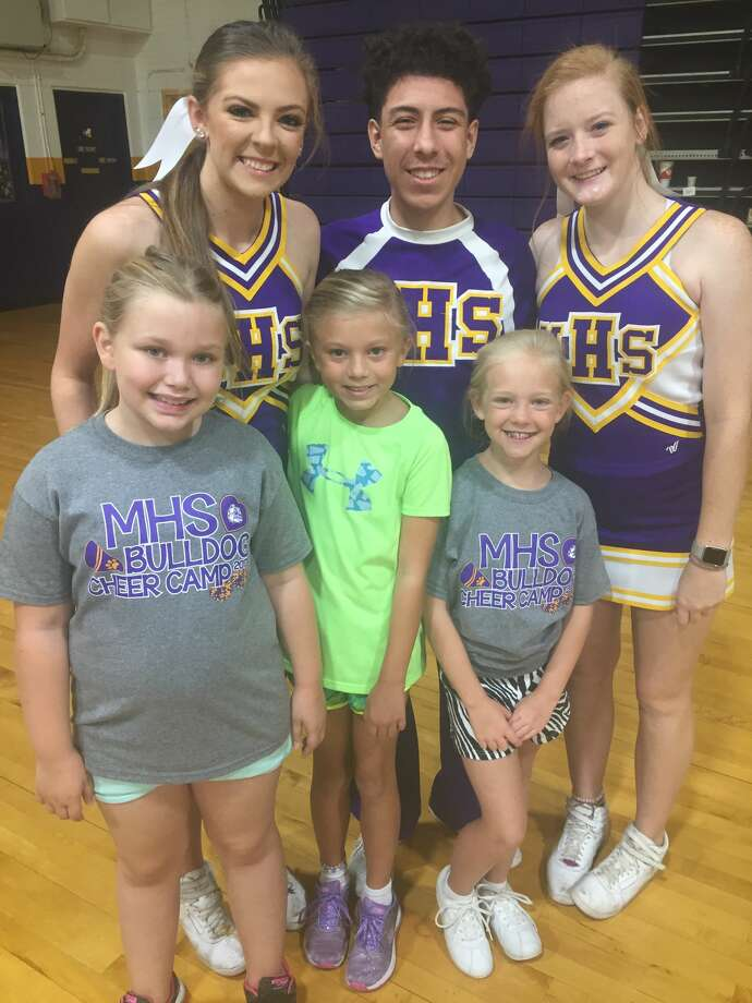Cheer camp: Mackynlie Conklin, back row from left, Arnold Gallegos and Sara Wheeless; and Alana Mains, front row from left, Kylie Morales and Camryn Dobson Photo:  Courtesy Photo