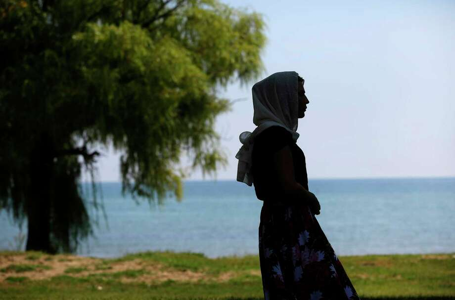 Leyla, a transgender woman from Chechnya, poses for a portrait along Lake Michigan in Chicago. Photo: Joshua Lott For The Washington Post. / The Washington Post