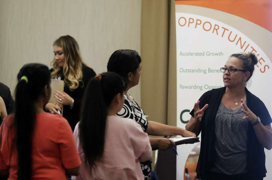 A recruiter for retailer Big 5 Sporting Goods, talks to job seekers during a recent job fair in San Jose, Calif. On Friday, the government reported that businesses added fewer employees than expected in August. Photo: Marcio Jose Sanchez /Associated Press / Copyright 2017 The Associated Press. All rights reserved.