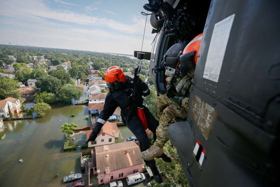 Brian Archibald, a rescue specialist assigned to the South Carolina Helicopter Aquatic Rescue Team Delta in McEntire Joint National Guard Base, S.C., points to a someone who may need help August 31, 2017 in Port Arthur, Texas. The SC-HART are specialized in search and rescue and are capable of recovering people in distress. (Air National Guard photo by Staff Sgt. Daniel J. Martinez/Released) Photo: By SSgt Daniel Martinez, DVIDS