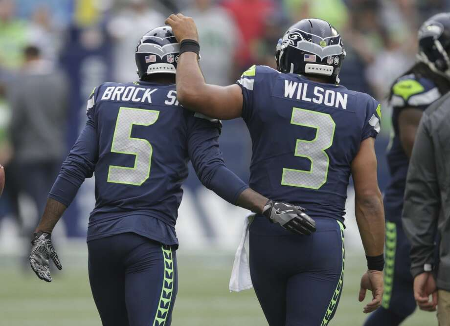 Seahawks cornerback Tramaine Brock (5) is greeted by quarterback Russell Wilson (3) during warmups before an NFL football preseason game against the Minnesota Vikings, Friday, Aug. 18, 2017, in Seattle. Photo: Scott Eklund/AP
