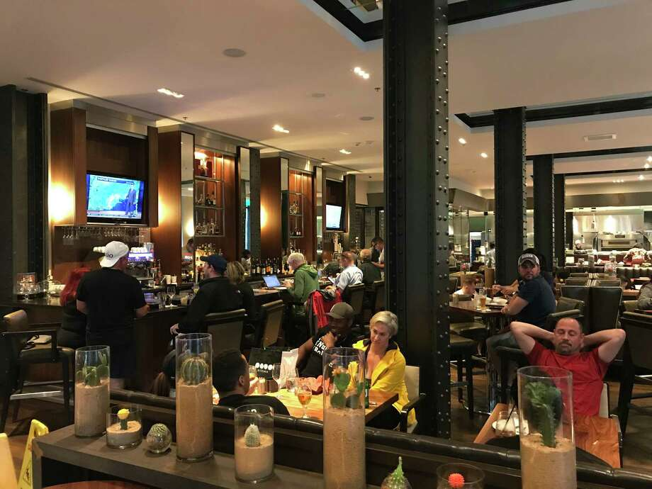 The lobby bar and restaurant at JW Marriott Downtown  filled up quickly with stranded tourists and downtown residents seeking refuge during Hurricane Harvey. Photo: Greg Morago
