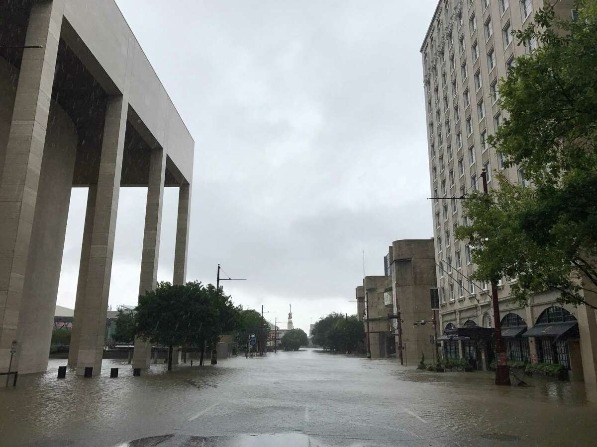 The Lancaster Hotel, at right, took on water during Hurricane Harvey.