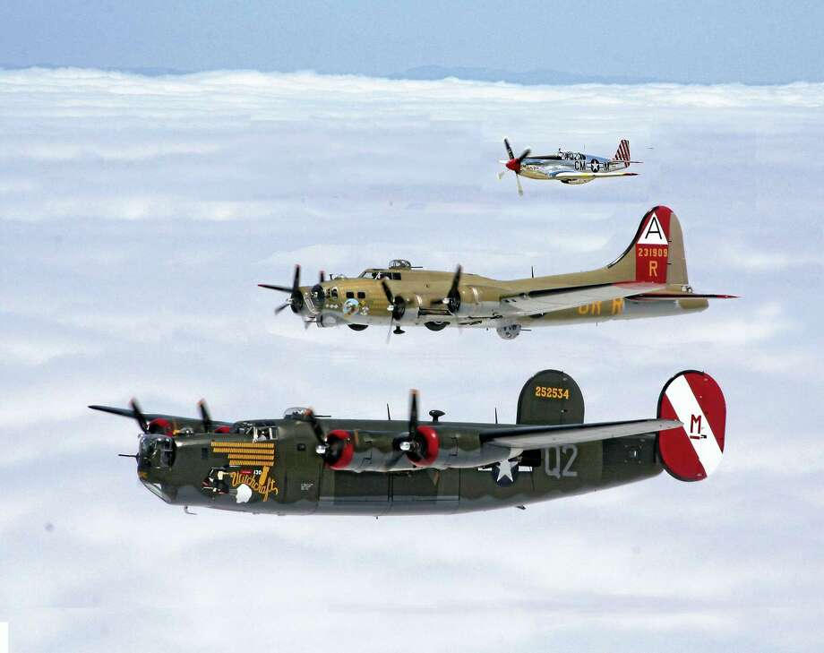 A B-24 Liberator, B-17 Flying Fortress and P-51 Mustang fly in formation as part of the Collings Foundation's Wings of Freedom Tour. Photo: Photo Courtesy Of Collings Foundation
