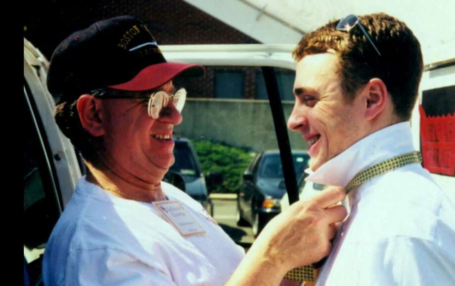 """""""Man in Red Bandana"""" — the documentary about hero Welles Crowther, who saved countless strangers when terrorists attacked the World Trade Center on Sept. 11, 2001 — will be screened at the Danbury Palace on Friday, Sept. 8. Crowther, right, who died in the tragedy, with his father. Photo: Alison Crowther / Contributed Photo"""