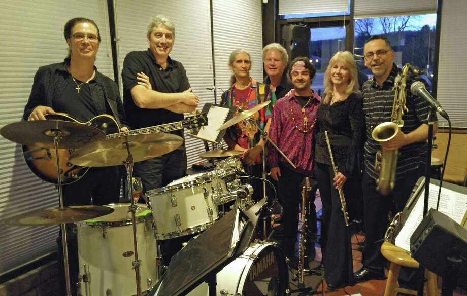 A band of Joni Mitchell fans will be bringing her music to the masses this weekend in Newtown. From left are guitarist Tony DiPaolo, drummer Roger Post, bassist Steve Zerlin, keyboardist Christian Martirano, percussionist Matt Spencer, singer and flutist Leslie Ballard and saxophonist and clarinetist Steve Moran. Photo: Contributed Photo / Connecticut Post contributed