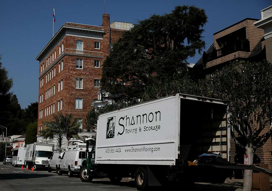 A moving truck is parked outside the Russian consulate in San Francisco Thursday after it was ordered closed. Photo: Justin Sullivan, Getty Images
