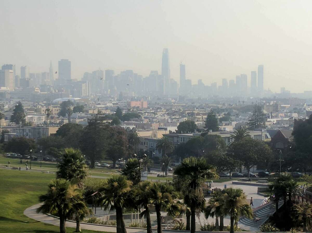 A smoke-filled view of San Francisco's skyline from Dolores Park on Sept. 1, 2017