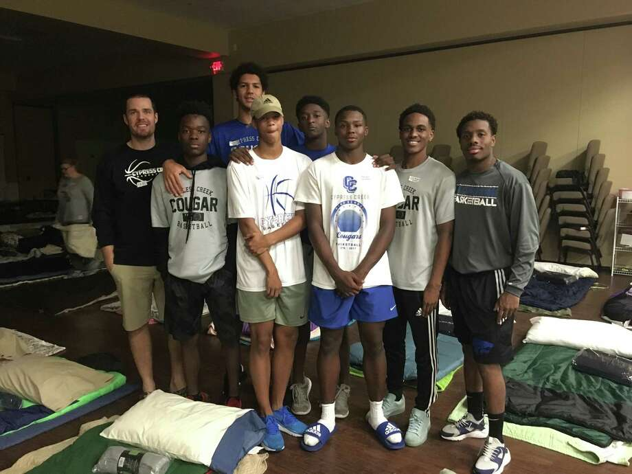 Dan Trocuqet (left) with his Cy Creek Cougars, helping out with Harvey recovery efforts. Trocuqet said his Coogs were ready to go even as the storm hit, strategizing how they might help out in a group text thread. Since then, Cy Creek Basketball has gone door to door, gutting homes and helping in a variety of other ways, in the process growing closer as a team and as a Cy Creek community. Photo: C/o Cy Creek Basketball